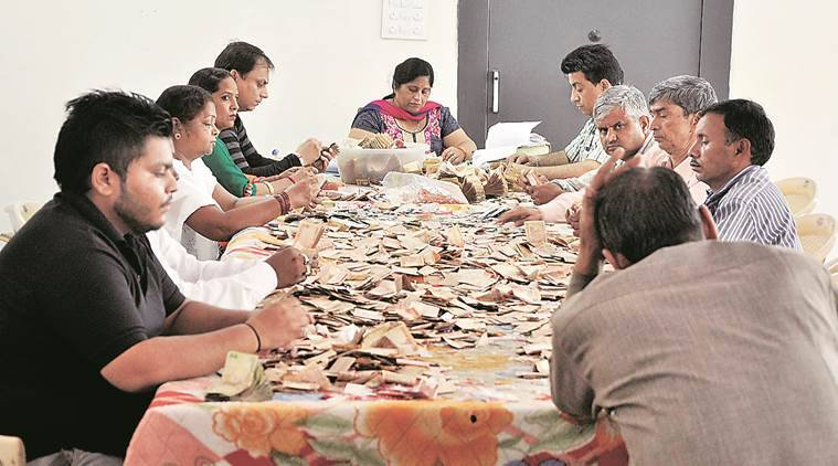 Officials count donations  at Mansa Devi temple in Panchkula. (Express Photo by Sahil Walia)