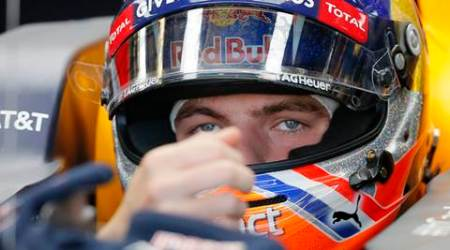 Red Bull driver Max Verstappen of the Netherlands, sits in his car before qualifications for the Formula One U.S. Grand Prix auto race at the Circuit of the Americas, Saturday, Oct. 22, 2016, in Austin, Texas. (AP Photo/Tony Gutierrez)