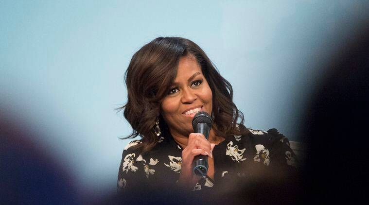 "First lady Michelle Obama speaks during Glamour's ""A Brighter Future: A Global Conversation on Girls' Education,"" in celebration of International Day of the Girl and Let Girls Learn, Tuesday, Oct. 11, 2016, at the Newseum in Washington. (AP Photo/Molly Riley)"