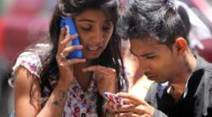 Students checking their 12th results in cyber cafes and on their mobile phones online in Sadashiv Peth area on Wednesday. Express Photo by Arul Horizon, 26-05-2015, Pune
