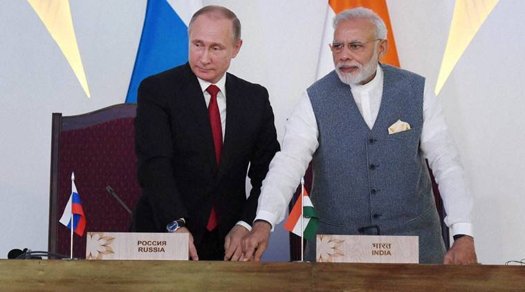 Benaulim: Prime Minister Narendra Modi with Russian President Vladimir Putin the laying of the foandation concrete of the Kudankulam Nuclear Power Plant units 3 & 4 at the agreement exchange ceremony after the 17th India-Russia annual summit meet in Benaulim, Goa on Saturday. PTI Photo by SUbhav Shukla (PTI10_15_2016_000100B) *** Local Caption ***