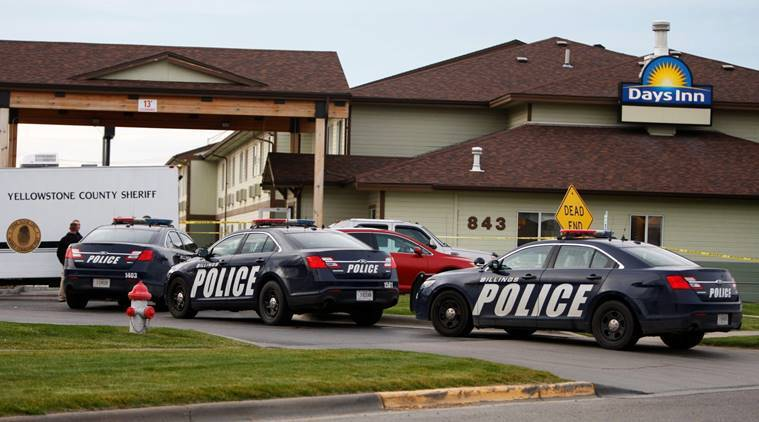 Investigators work at the scene of an officer-involved shooting at the Days Inn on Thursday, Oct. 27, 2016, in Billings, Mont. A police officer shot and killed a Wyoming man at the hotel early Thursday, Police Chief Rich St. John said. The man was in the hotel clerk's office with a handgun, refused orders to drop the weapon and was turning to face officers when Officer David Rashkow fired shots, hitting the man in the chest, St. John told reporters. (Casey Page/The Billings Gazette via AP)