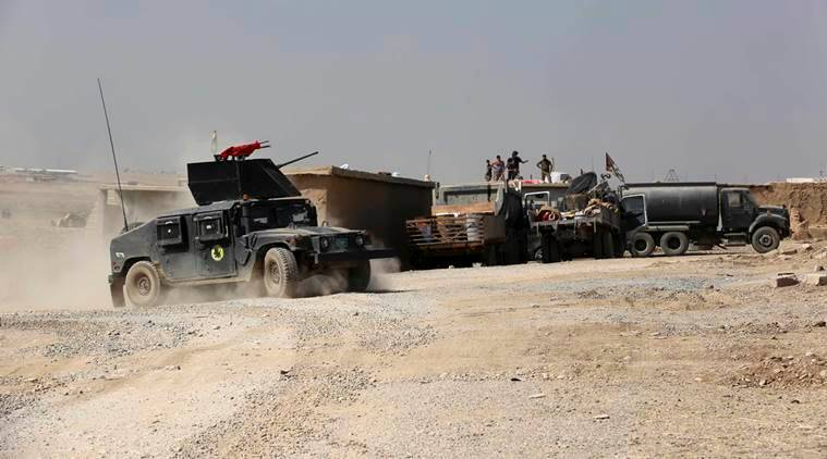 Iraqi forces are deployed during an offensive to retake Mosul from Islamic State militants outside Mosul, Iraq, Monday, Oct. 17, 2016. Columns of Iraqi and Kurdish forces backed by U.S.-led airstrikes slowly advanced on Mosul from several directions on Monday, launching a long-awaited operation to retake Iraq's second largest city from the Islamic State group. (AP Photo/Khalid Mohammed)