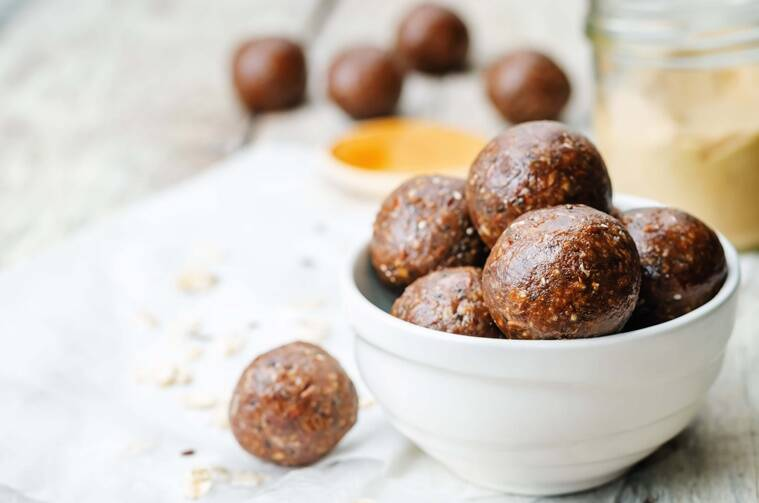 Raw vegan peanut butter oat coconut cacao balls. the toning. selective focus