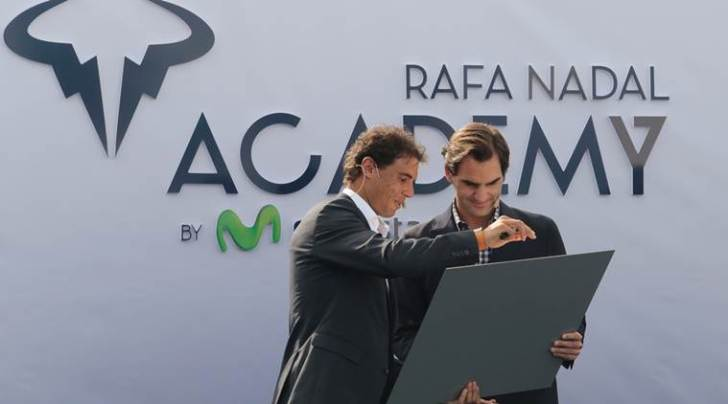 Switzerland's Federer holds a gift given by Spain's Nadal during the opening ceremony of the Rafa Nadal tennis academy in Manacor