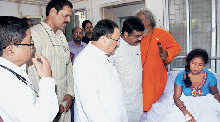 Union Health Minister J P Nadda and Petroleum Minister Dharmendra Pradhan interact with survivors of the SUM Hospital fire at Capital Hospital, also in Bhubaneswar. (PTI Photo)
