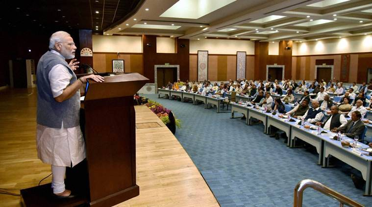 New Delhi: Prime Minister Narendra Modi addressing at a meeting with Secretaries to the Government of India, at Pravasi Bharatiya Kendra in New Delhi on Thursday. PTI Photo  (PTI10_27_2016_000232B)