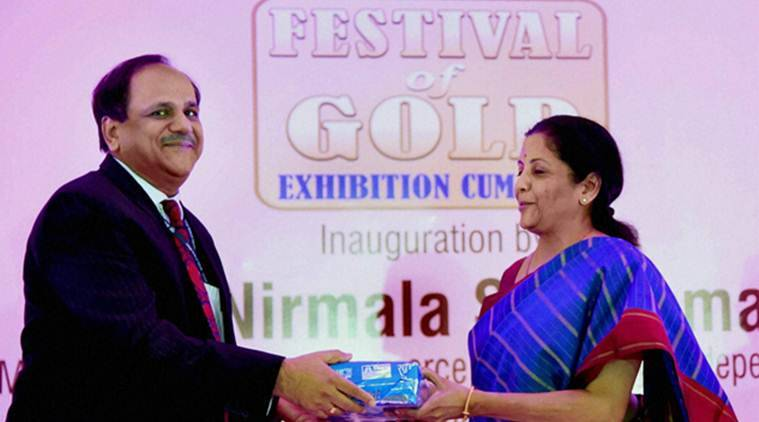 New Delhi: Union Commerce & Industry Minister Nirmala Sitharaman receiving a memento from Chairman and Managing Director of MMTC, Ved Prakash at the inauguration of MMTC 'Festival of Gold' in New Delhi on Thursday.PTI Photo by Atul Yadav(PTI10_20_2016_000019A)