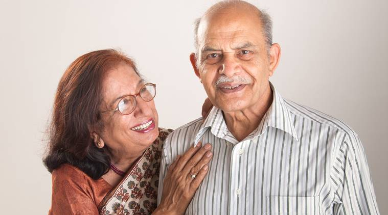 A senior Indian couple sharing a laugh together