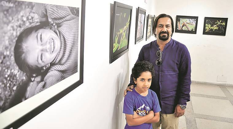 Mitul Dixit with his son at Punjab Kala Bhavan in Sector 16, Chandigarh, Wednesday. Sahil Walia