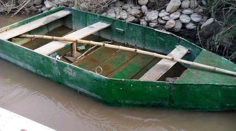 A country made Pakistani boat seized by BSF, the boat had drifted into river Ravi in India which created panic of an infiltration bid. (Express Photo)