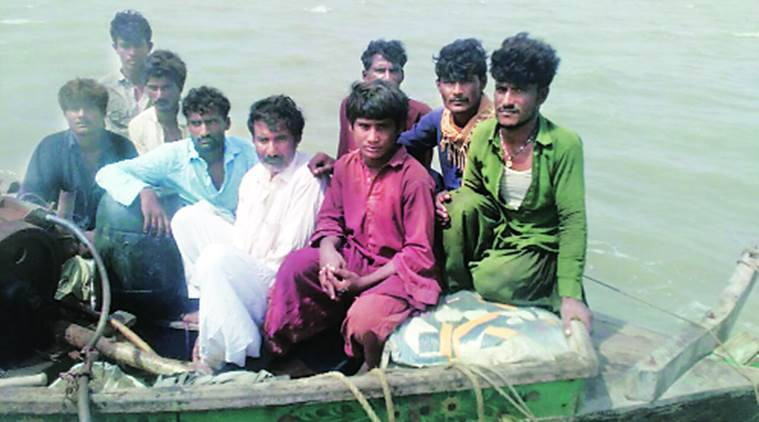 The nine Pakistani nationals held with the boat. Express Photo