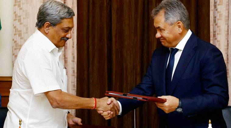 New Delhi: Defence Minister Manohar Parrikar and his Russian counterpart Sergey Shoigu exchange protocol document after the 16th meeting of the India-Russia Intergovernmental Commission on Military-Technical Cooperation in South Block, New Delhi on Wednesday. PTI Photo (PTI10_26_2016_000279B)
