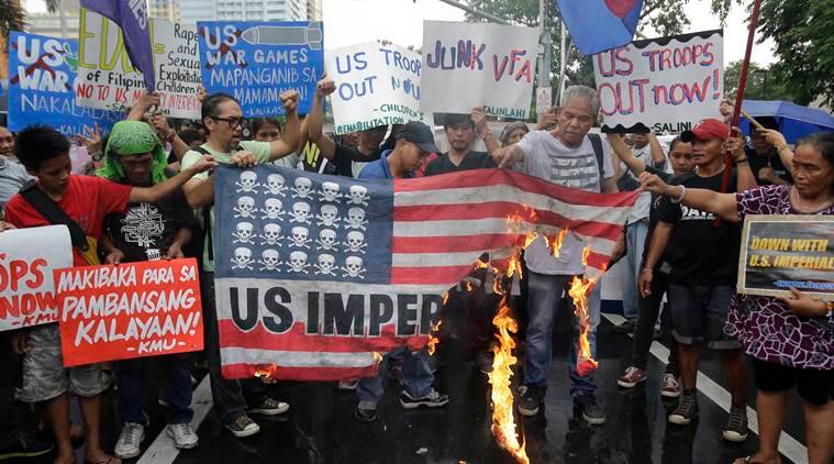 Filipino activists burn a mock U.S. flag during a rally against the Enhanced Defense Cooperation Agreement (EDCA) between the U.S. and Philippines in front of the U.S. embassy in Manila, Philippines on Tuesday, Oct. 4, 2016. U.S. and Philippine forces opened their first large scale combat exercises under President Rodrigo Duterte in uncertainty Tuesday after he said the drills will be the last in his six-year presidency partly to avoid upsetting China. (AP Photo/Aaron Favila)