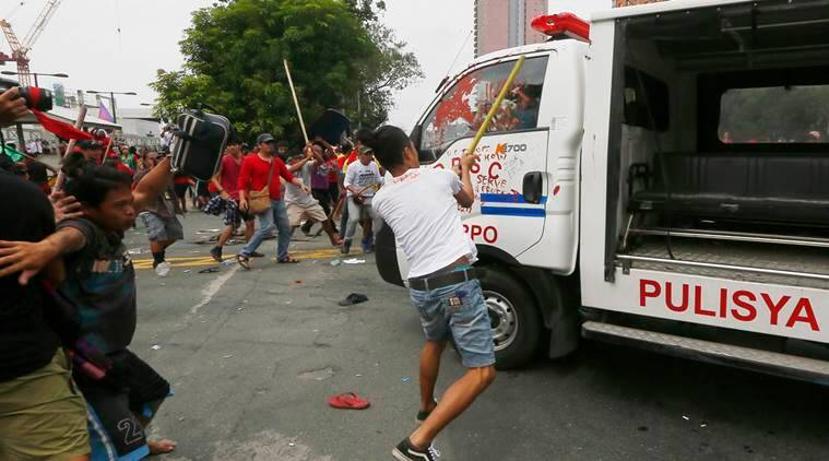 philippines, manila, philippine police, bus rams into protesters, philippines police, philippines us embassy, philippines us embassy accident, philippines anti-us protest, world news