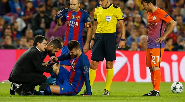 Football Soccer - FC Barcelona v Manchester City - UEFA Champions League Group Stage - Group C - The Nou Camp, Barcelona, Spain - 19/10/16 Barcelona's Gerard Pique receives medical attention after a challenge by Manchester City's David Silva as Andres Iniesta and referee Milorad Mazic look on Reuters / Albert Gea Livepic EDITORIAL USE ONLY.