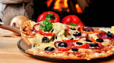 Pizaa, pizza italy, pizza naples, pizza eating ways, pizza eating right way, pizza eating wrong way,. pizza eating wallet technique, traditional pizza eating way, pizza folding and eating way, food news, lifestyle news, latest news, indian express