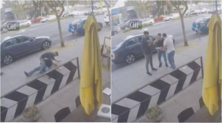pizza, pizza video, pizza man, street fight, street fight footage, pizza man stop street fight, pizza stops street fight, viral cctv video, funny video, viral video, trending video, latest news, indian express
