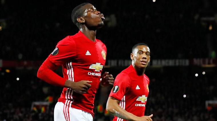 Britain Football Soccer - Manchester United v Fenerbahce SK - UEFA Europa League Group Stage - Group A - Old Trafford, Manchester, England - 20/10/16 Manchester United's Paul Pogba celebrates scoring their first goal from the penalty spot with Anthony Martial  Action Images via Reuters / Jason Cairnduff Livepic EDITORIAL USE ONLY.