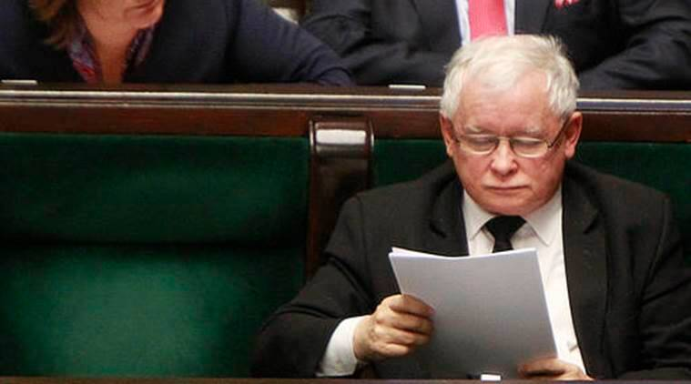 Jaroslaw Kaczynski, right, head of the ruling Law and Justice party, reads before votes in a parliament to reject a proposal to restrict the abortion law in Warsaw, Poland, Thursday, Oct. 6, 2016., 2016. He was one of the lawmakers who objected a proposal by an anti-abortion group that would have imposed a total ban on abortion. (AP Photo/Czarek Sokolowski)