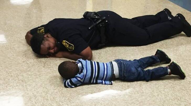police, police comforts crying chil, cop talks to child facebook post, indiana cop facebook post child, indiana cop comforts crying child, indian express, indian express news