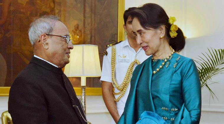 RPT...New Delhi: President Pranab Mukherjee shakes hands with   Myanmar's State Counsellor and Foreign Minister Aung San Suu Kyi at the Rashtrapati Bhavan in Delhi on Tuesday.PTI Photo (PTI10_18_2016_000096B)