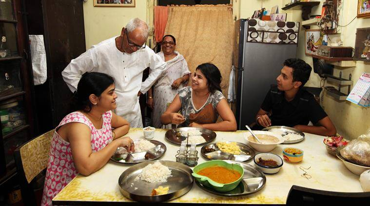 The octogenarian 'king' of Sovabazar, Alok Krishna Deb, with his family in his flat. (Source: Express photo by Partha Paul)