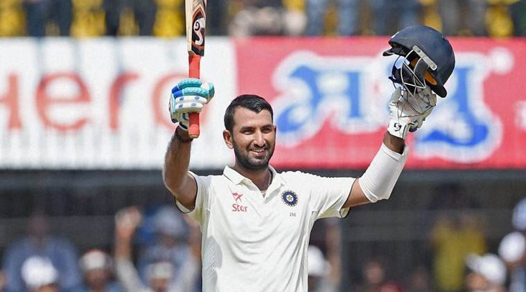 Indore:Indian batsman Cheteshwar Pujara celebrates his century during the third test match played against New Zealand in Indore on Tuesday. PTI Photo by Shashank Parade(PTI10_11_2016_000079b)