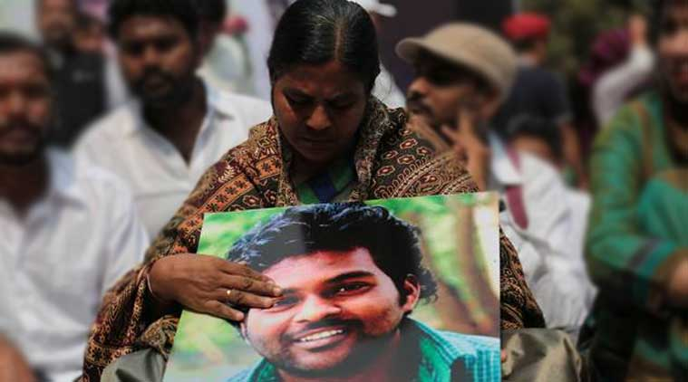 Rohith Vemula's mother holds a picture of her son during a protest. Express Photo