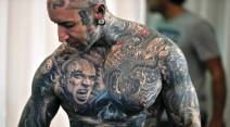 A man shows his tattoos during the International Tattoo Convention Bucharest 2016 in Bucharest, Romania, Sunday, Oct. 16, 2016. Prominent tattoo artists from across the world displayed their skills in the Romanian capital over the weekend. (AP Photo/Vadim Ghirda)