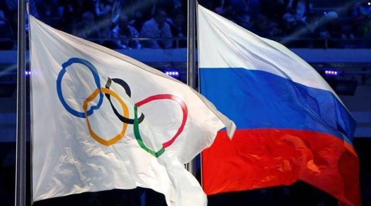 Russian national flag and Olympic flag are seen during closing ceremony for 2014 Sochi Winter Olympics