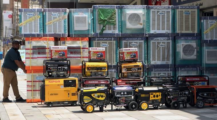 FILE - In this Thursday, July 30, 2015 file photo, air conditioners and power generators are displayed on a street in central Baghdad, Iraq. Nations reached a deal Saturday, Oct. 15, 2016 to limit the use of hydrofluorocarbons, or HFCs - greenhouse gases far more powerful than carbon dioxide that are used in air conditioners and refrigerators, in a major effort to fight climate change. (AP Photo/ Khalid Mohammed, File)