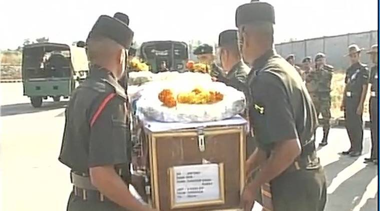 Martyr Sandeep Singh Rawat's mortal remains being carried by soldiers. ANI photo