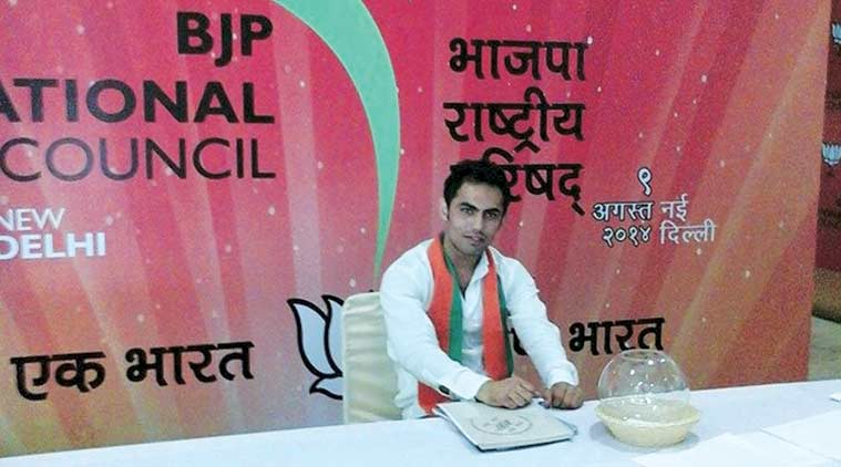 Hussain poses with a BJP poster, on his Facebook page