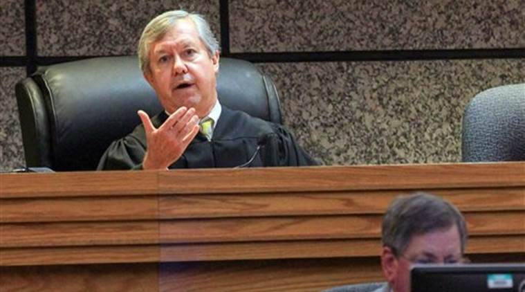 Judge Edgar Long presides over a hearing of a 14-year old, who was charged as a juvenile Friday, Sept. 30, 2016  in Anderson, S.C.,  with murder and three counts of attempted murder after authorities say he killed his father and opened fire on students at a playground, wounding three people. The Associated Press typically does not identify juveniles charged with crimes. Authorities have not released a motive for the school shooting or killing.   (Ken Ruinard /The Independent-Mail via AP, Pool)