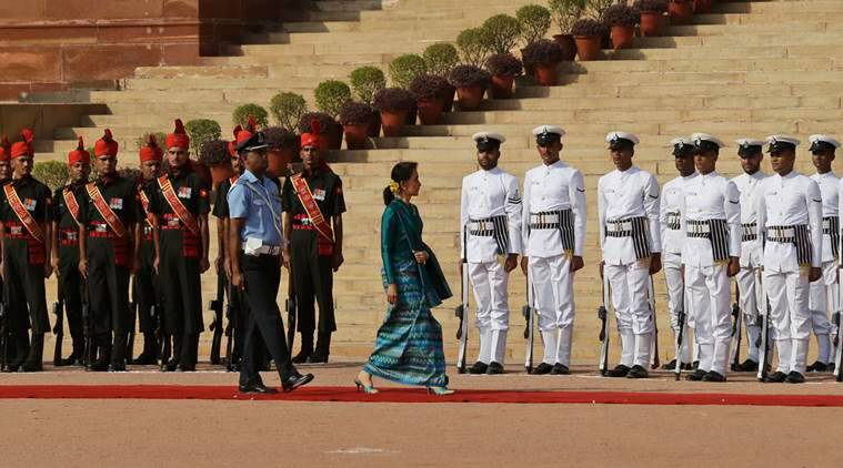 Myanmar's Foreign Minister Aung San Suu Kyi inspects a guard of honor during her ceremonial reception in New Delhi, India, Tuesday, Oct. 18, 2016, (AP Photo/Saurabh Das)