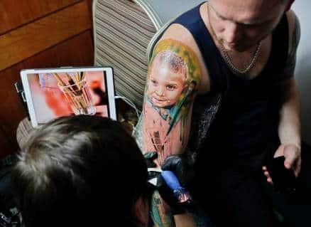 tattoo, intresting tattoo, tattoo design, seventh international tattoo convention, romania international tattoo convention, indian express, indian express news
