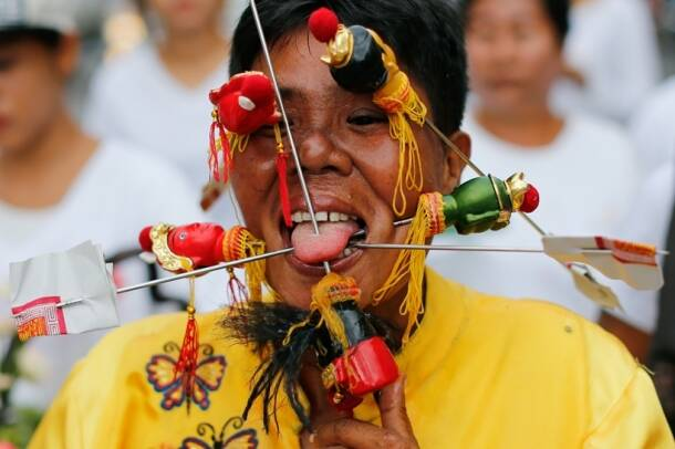 "thai vegetarian festival, Swords and skewers at Thailand, ""Nine Emperor Gods"" festival, Jia Chai, indian express, indian express news"