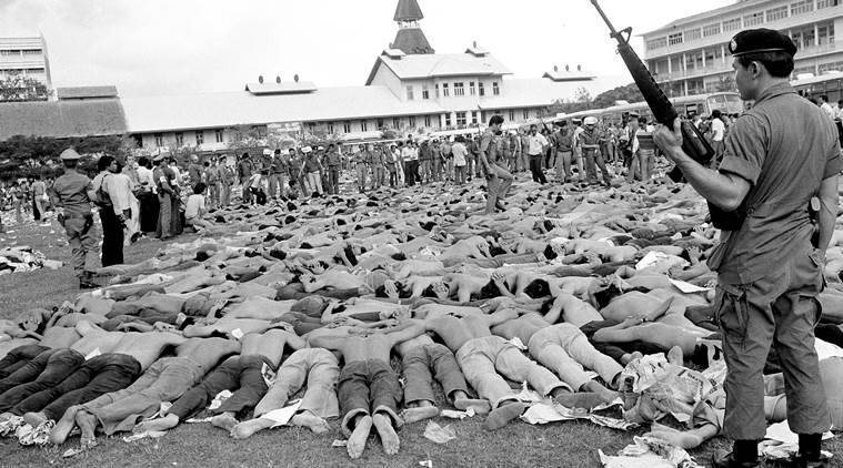 thailand, thailand killings, Pulitzer Prize-winning photo, David Tucker, october 6, 6 october 1976, 1976 thialand, Neal Ulevich, Neal Ulevich Pulitzer, Bangkok Thammasat University, history, thiland history, on this day, latest news, latest world news