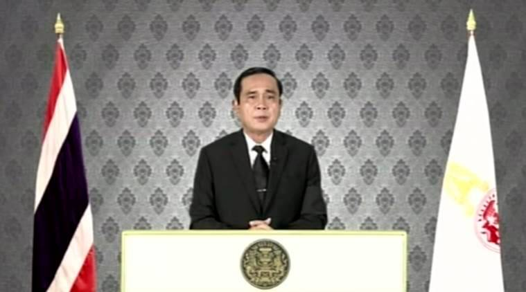 In this image made from video, Thailand's Prime Minister Prayuth Chan-ocha speaks about the passing of Thai King Bhumibol Adulyadej in Bangkok, Thursday, Oct. 13, 2016. Prayuth announced that Thai Crown Prince Maha Vajiralongkorn will be the new monarch in accordance with the constitution. He said government officials will observe a one-year mourning period. (NBT via AP)