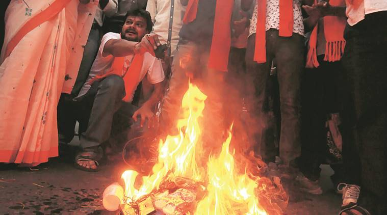 vhp burns chinese products, chinese products burn, kolkata vhp chinese products, indian express,