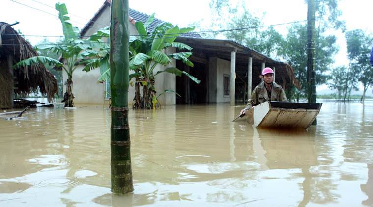 Vietnam, vietnam floods, vietnam flood deaths, vietnam flood death toll, vietnam flood toll, vietnam storm, storm warning, world news, indian express