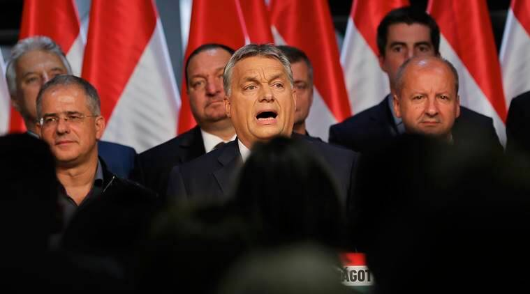 Hungarian Premier Viktor Orban delivers a speech in front of supporters in Budapest, Hungary, Sunday, Oct. 2, 2016. Hungarians overwhelmingly supported the government in a referendum on Sunday called to oppose any future, mandatory European Union quotas for accepting relocated asylum seekers but nearly complete official results showed the ballot was invalid due to low voter turnout.(AP Photo/Vadim Ghirda)