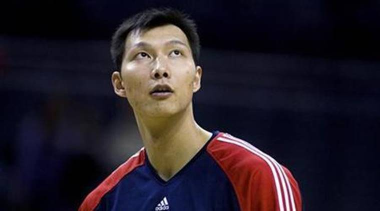 New Jersey Nets forward Yi Jianlian of China looks up while warming up prior to playing the Charlotte Bobcats in Charlotte