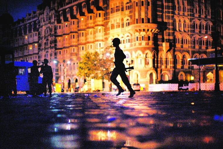 "The Intelligence failure in the run-up to the November 26 attacks and the crossed wires during the 60-hour siege *** Local Caption *** ""FOR USE AS DESIRED WITH YEAR END--FILE **In this Nov. 29, 2008 file photo, an Indian soldier runs to take cover in front of the Taj Mahal hotel as Indian troops and militants battle in Mumbai, India. (AP Photo/David Guttenfelder/FILE)"""