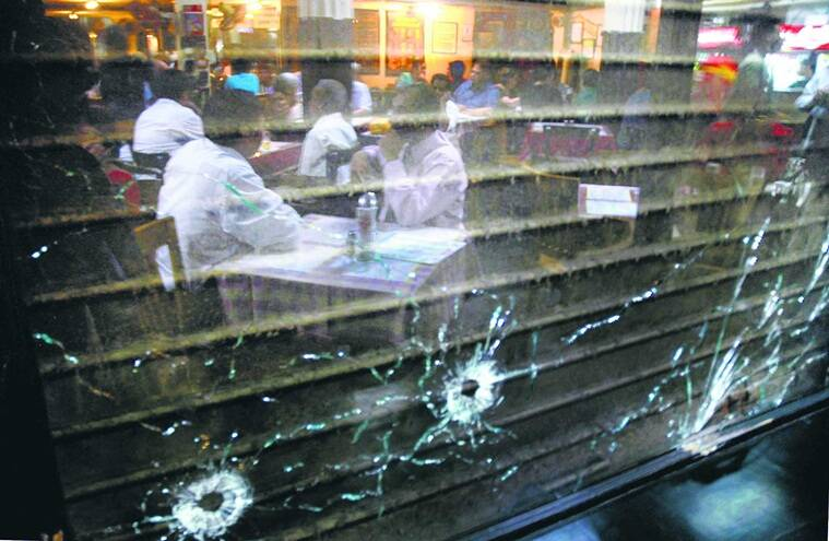 Customers start visiting Cafe leopold after the terrorist attack *** Local Caption *** Customers start visiting Cafe leopold after the terrorist attack on Monday. Express Photo by Pradip das, Mumbai, 01/12/2008