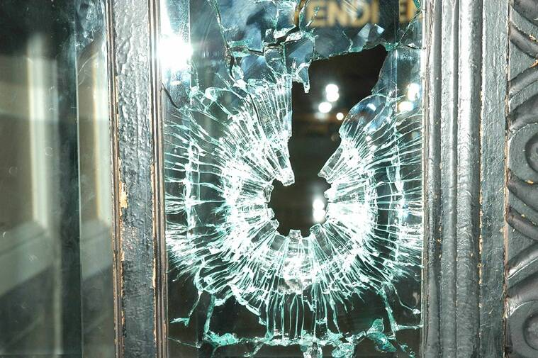 "Bullet marks on the glass at Cafe Leopold in Colaba. Vasant Prabhu *** Local Caption *** ""Bullet marks on the glass at Cafe Leopold after unidentiufied gunmen started firing at Colaba on Wednesday. Express Photo by Vasant Prabhu, 26/12/2008"""