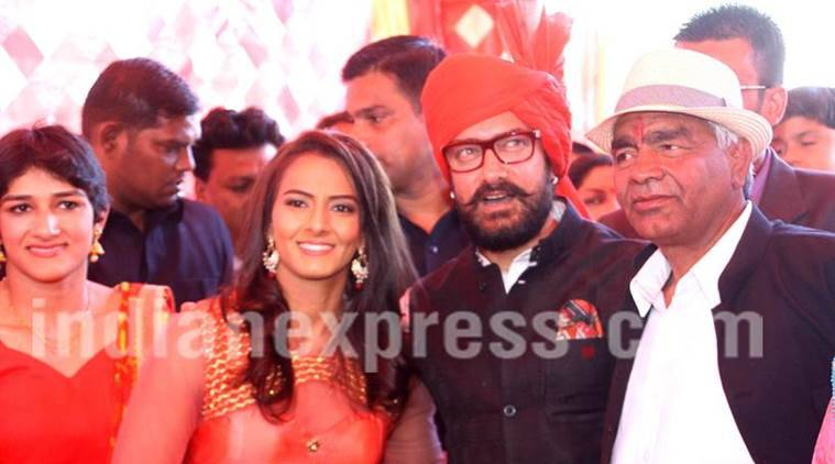 Superstar Aamir Khan with international wrestler Geeta Phogat at her wedding with Dangal film cast at Balali village of Charkhi Dadri district on Sunday.November 20, 2016: Express Photo