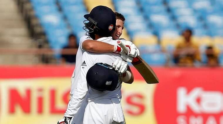 Cricket - India v England - First Test cricket match - Saurashtra Cricket Association Stadium, Rajkot, India - 9/11/16. England's Joe Root (R) celebrates with his teammate Moeen Ali after scoring his century. REUTERS/Amit Dave