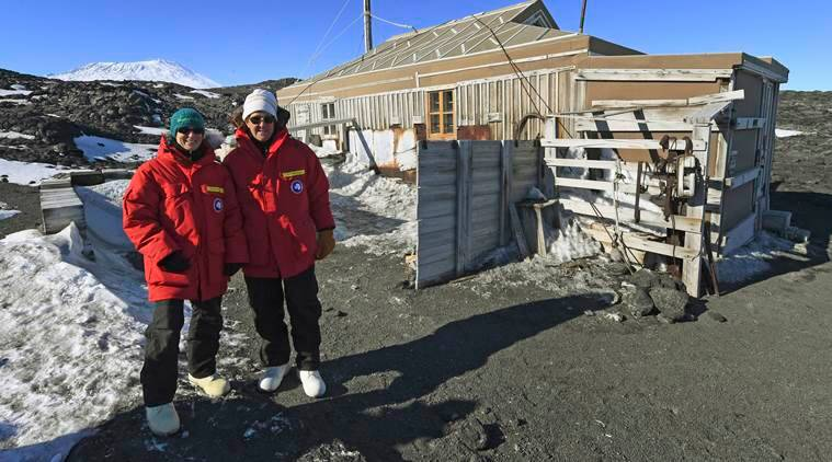 U.S. Secretary of State John Kerry, right, and scientist Kelly Falkner outside the historic Shackleton hut near McMurdo Station, Antarctica, Friday, Nov. 11, 2016. Secretary Kerry is traveling to Antarctica, New Zealand, Oman, United Arab Emirates, Morocco, and attending APEC in Peru on his 9 day trip. (Mark Ralston/Pool Photo via AP)